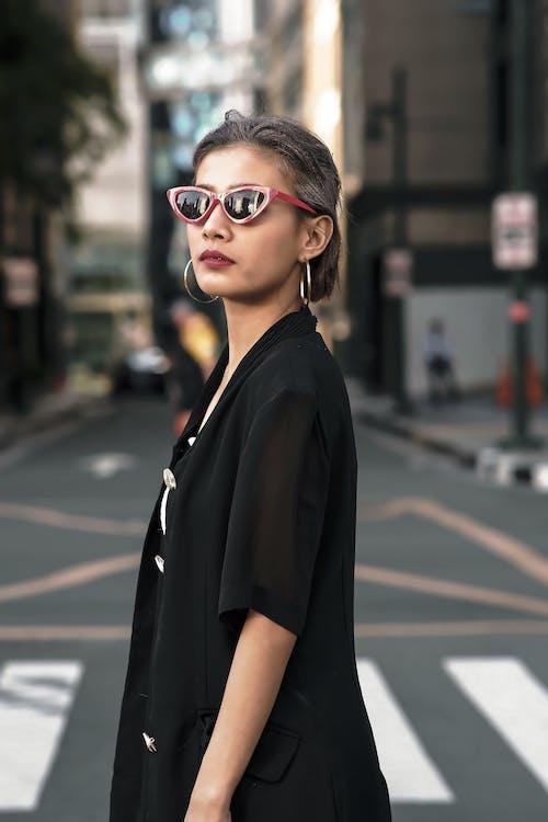 Woman in Black Top Standing on Pedestrian Lane