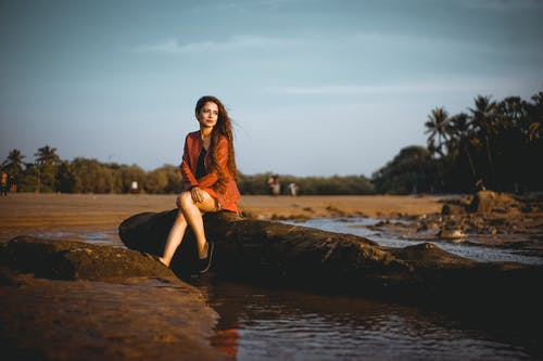 Shallow Focus Photo of Woman in Orange Long-sleeved Dress