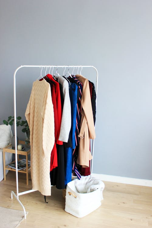 Assorted-colored Dresses on White Clothes Rack