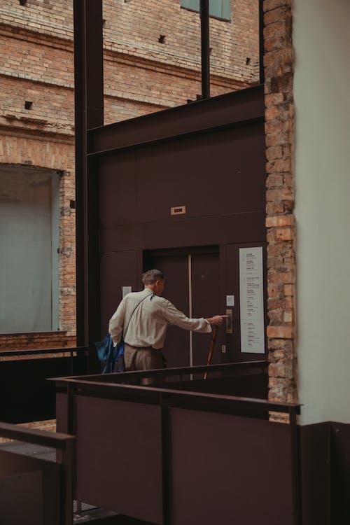 Man Standing Beside Elevator Door