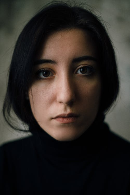 Shallow Focus Photo of Woman in Black Top