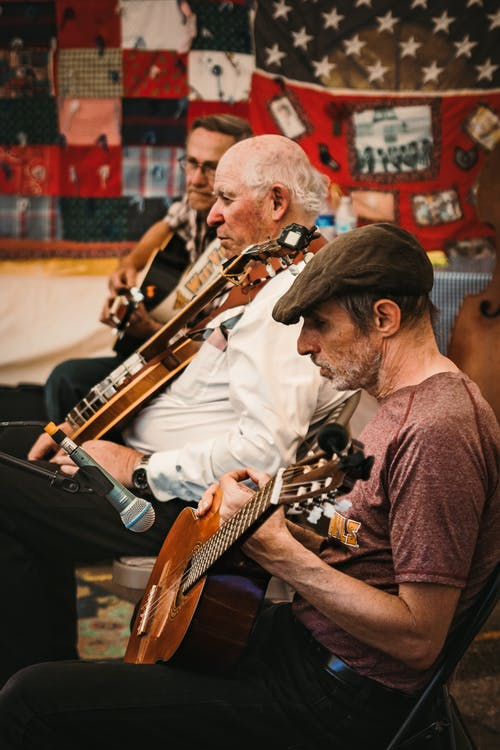 Photo of Men Playing Acoustic Guitar