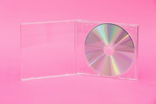 DVD, コンパクトディスク, ディスク, ピンクの背景の無料の写真素材