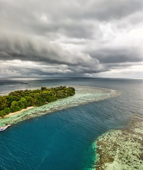 Aerial Photography of Islands Under Cloudy Sky