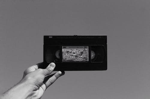 Grayscale Photography of Vhs Video Cassette