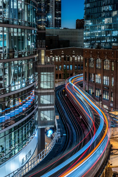 Time-Lapse Photography of Railway and Building during Nighttime