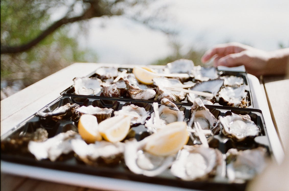 Selective Focus Photo of Oysters Ceramic Tray
