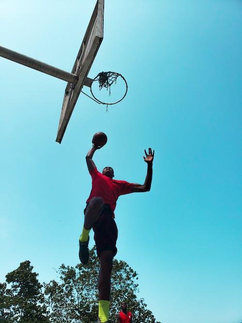 Low Angle Photo of Man Playing Basketball