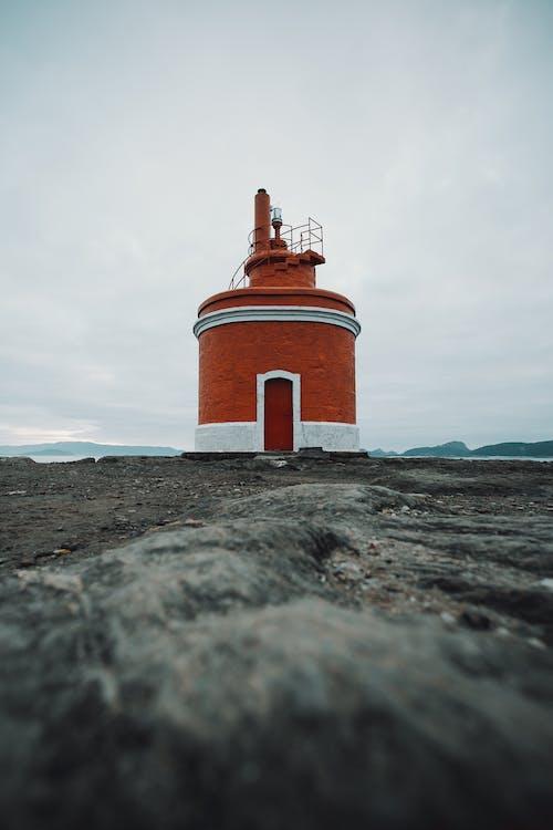Red Lighthouse Under Grey Sky