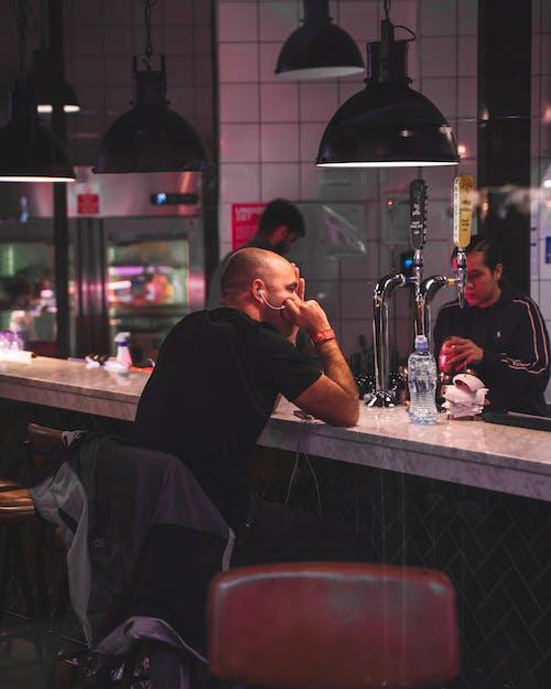 Man Sitting Inside Bar