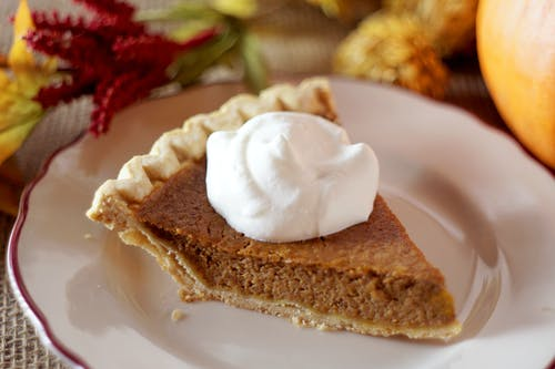 Close-Up Photo of Pumpkin Pie With Whipped Cream