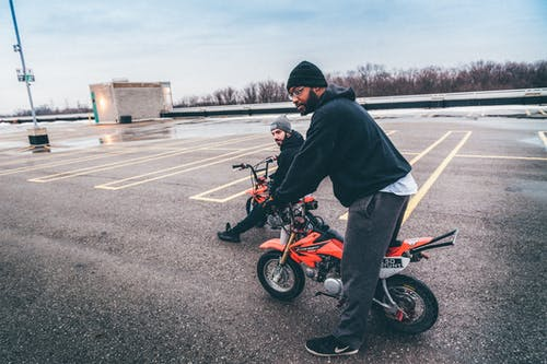 Photo Of Men Riding Dirt Bikes