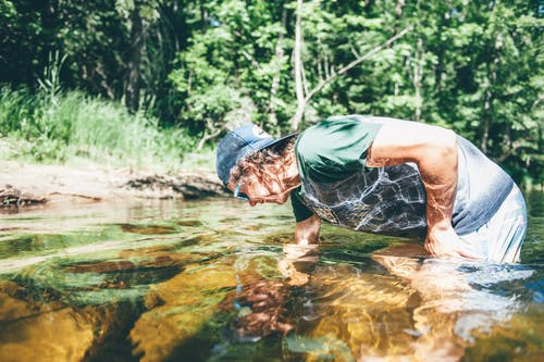 Man in Pond in Forest