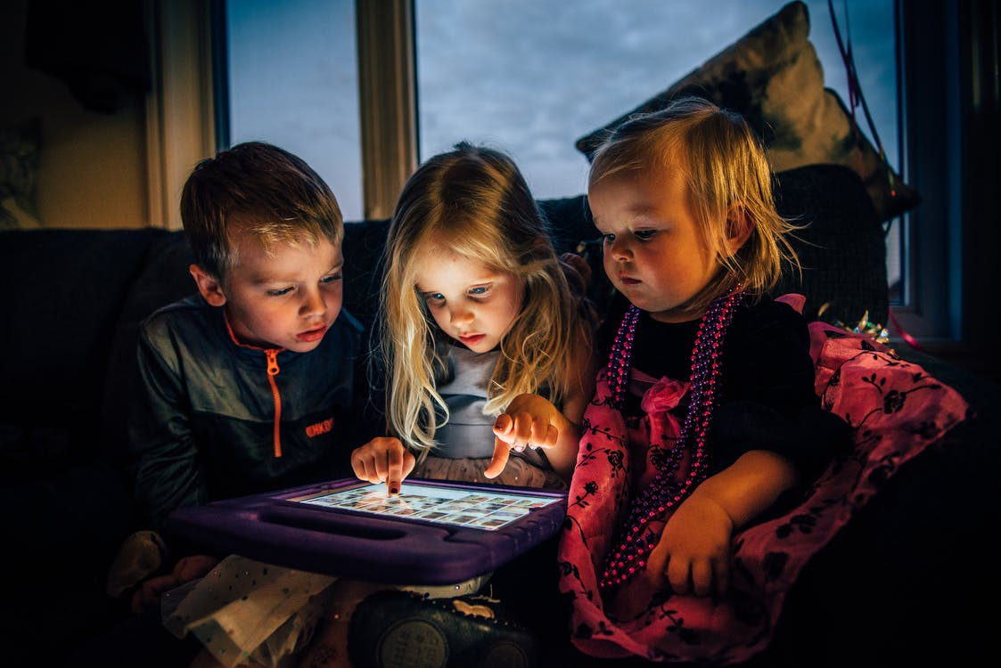 Three Children Looking at a Tablet Computer