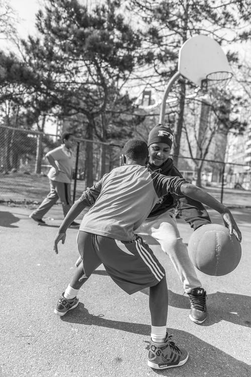 Monochrome Photo Of Boys Playing Basketball