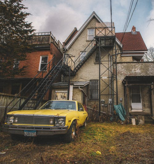 Photo Of Yellow Abandoned Car