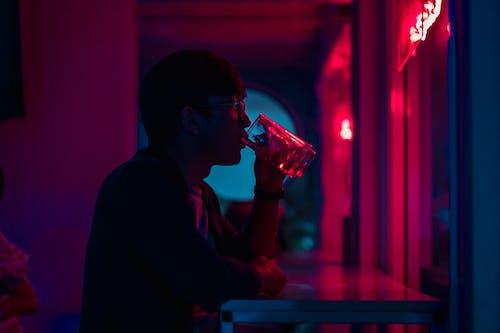 Man Drinking Beside Wall
