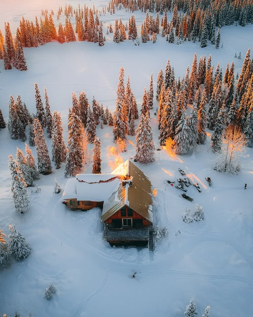 Aerial Photography of House, Field, and Trees Covered With Snow