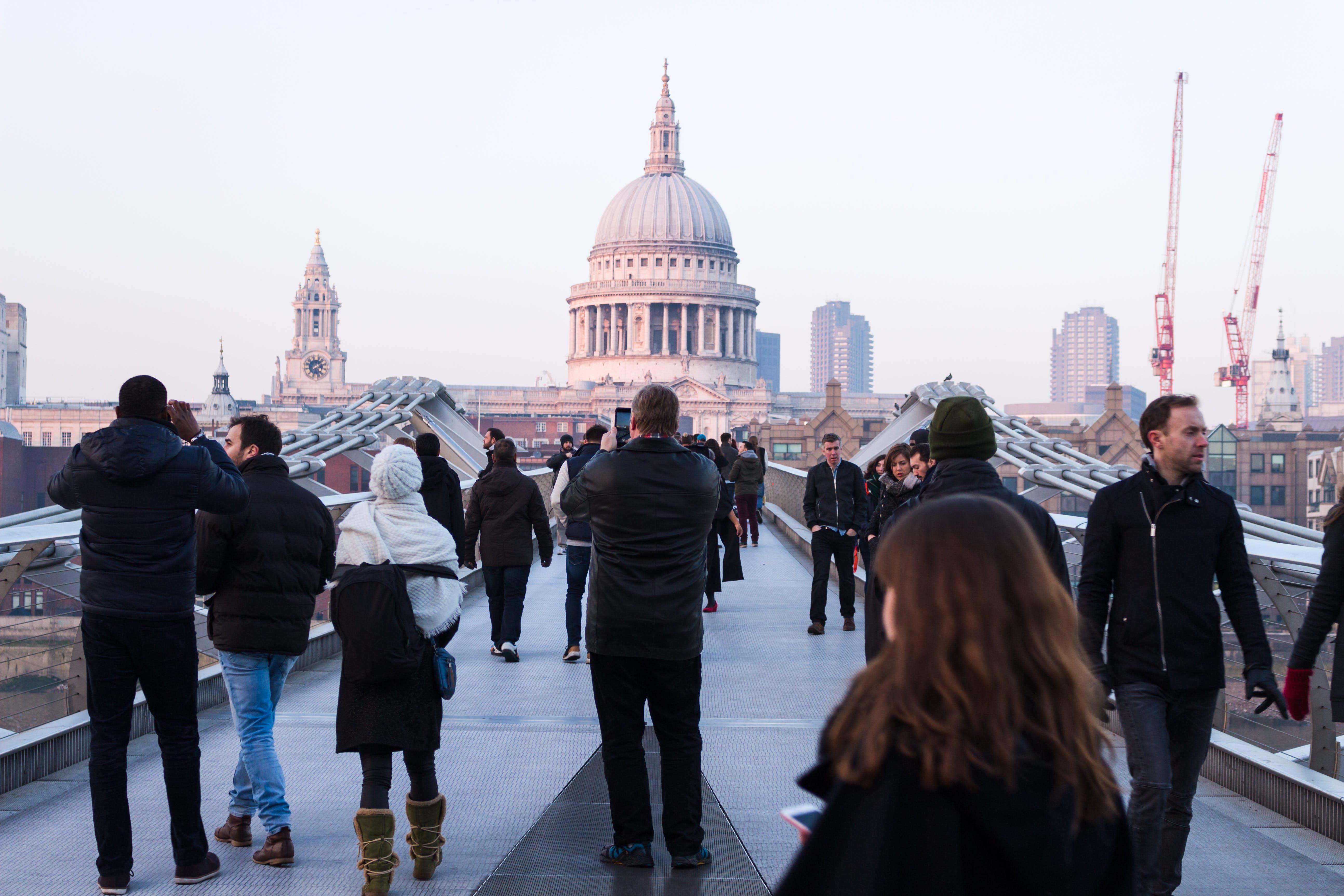 People Walking on Concrete Walkway Near Dome