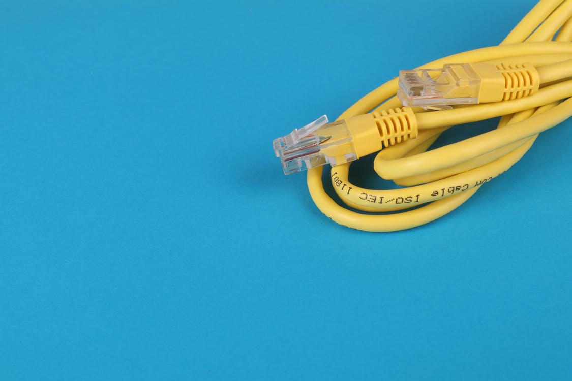 Yellow ethernet cable on blue background