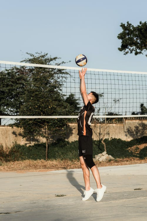 Photo Of Man Playing Volleyball