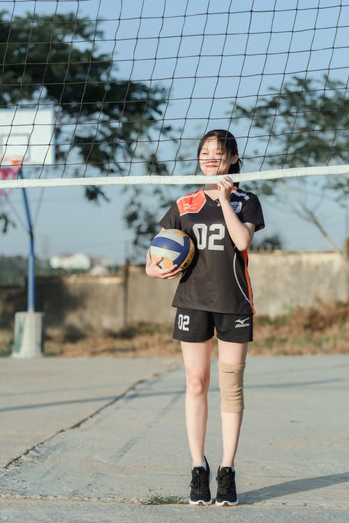 Photo Of Woman Holding Volleyball