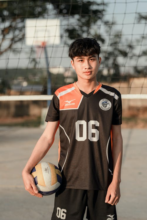 Photo Of Man Holding Volleyball
