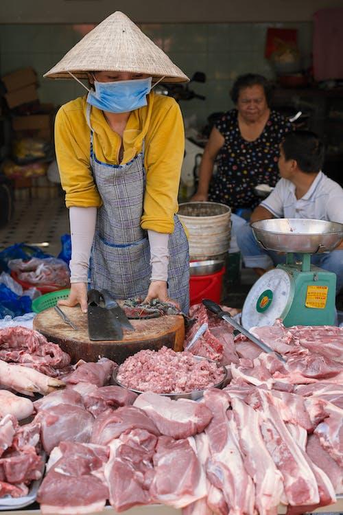Ingyenes stockfotó ázsiai nő, bódé, elad, eladó témában