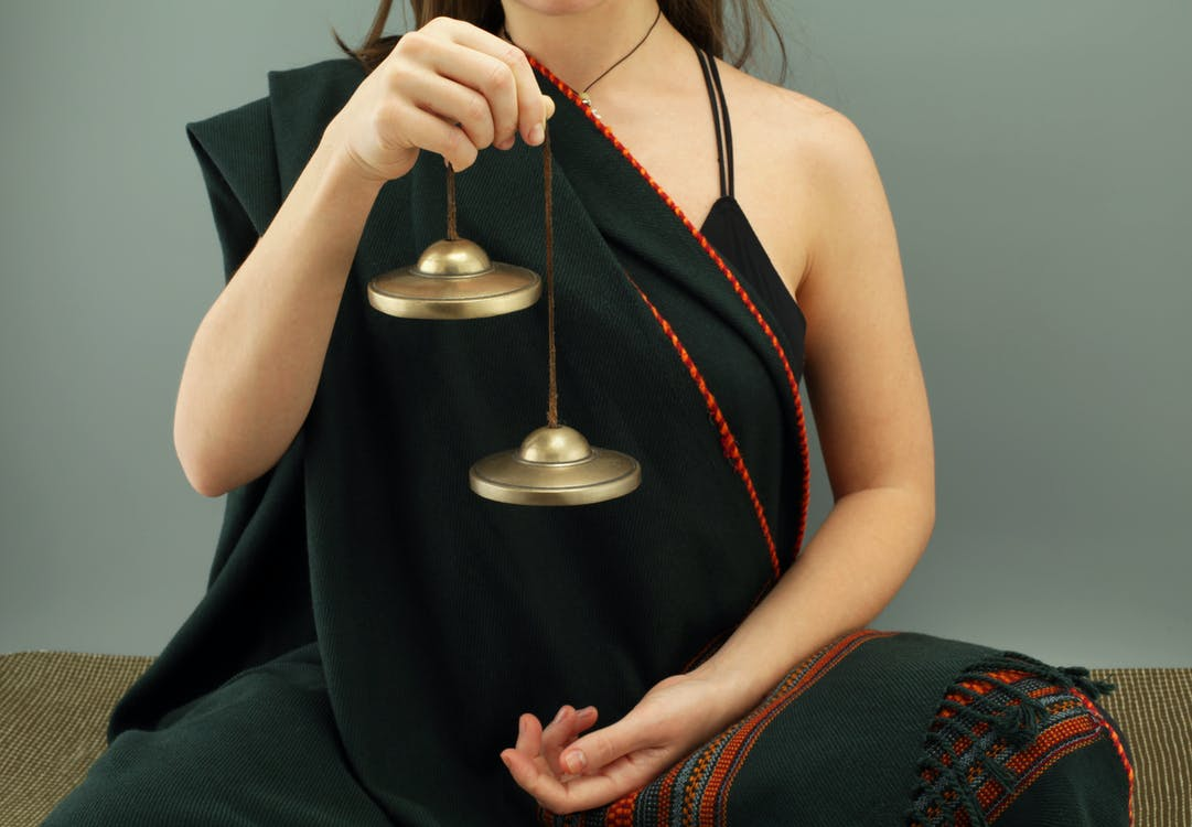 Woman Wearing Black Traditional Dress Holding a Tingsha