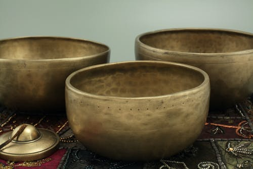 Close-up Photography of Bronze Bowls