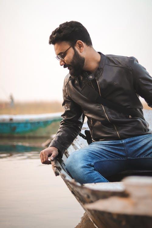 Man Sitting on Canoe