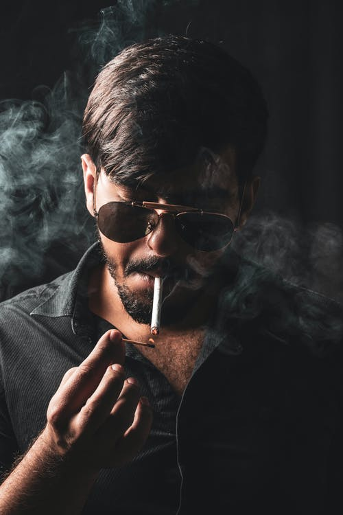 Selective Focus Photography Of Man Smoking Cigarette