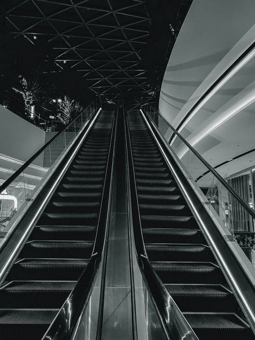 Grayscale Photography of Empty Escalator