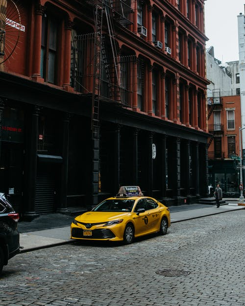 Photo of Yellow Taxi Parked on Street