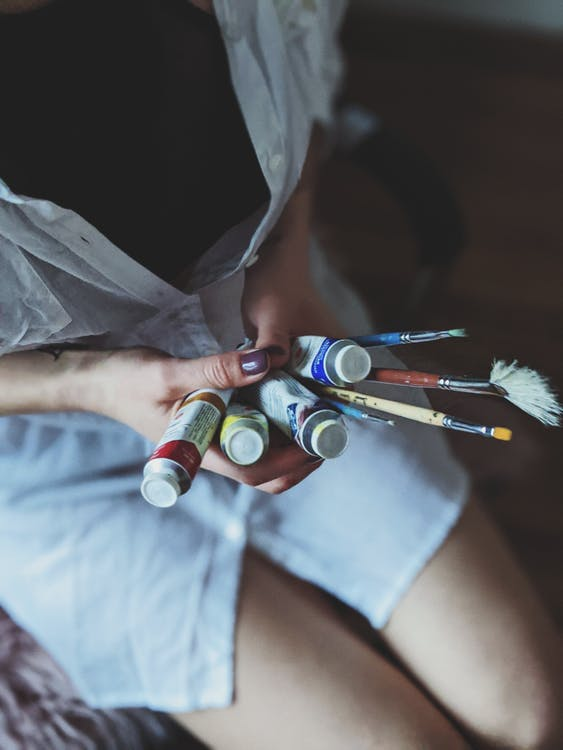 Woman Holding a Paint Brushes and Soft-tubes