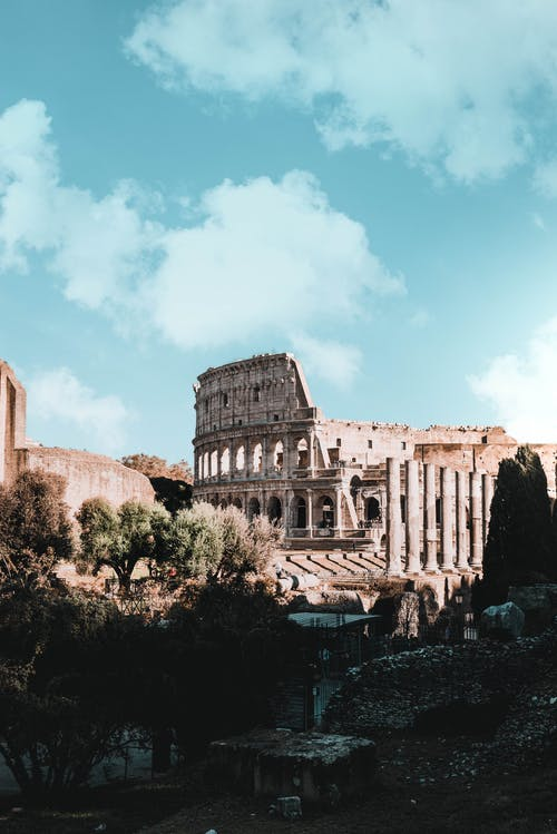 Colosseum Amphitheatre In Rome, Italy During Day