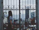person, woman, buildings