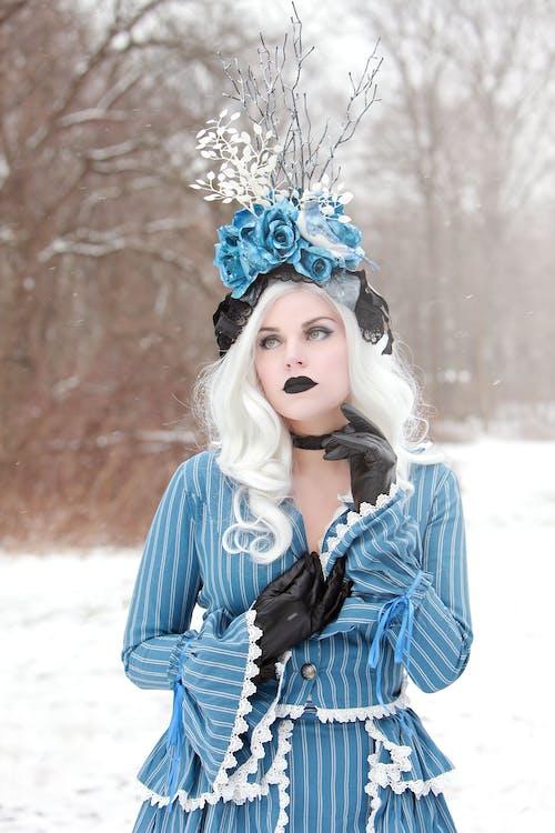 Woman Wearing Blue Long-sleeved Dress
