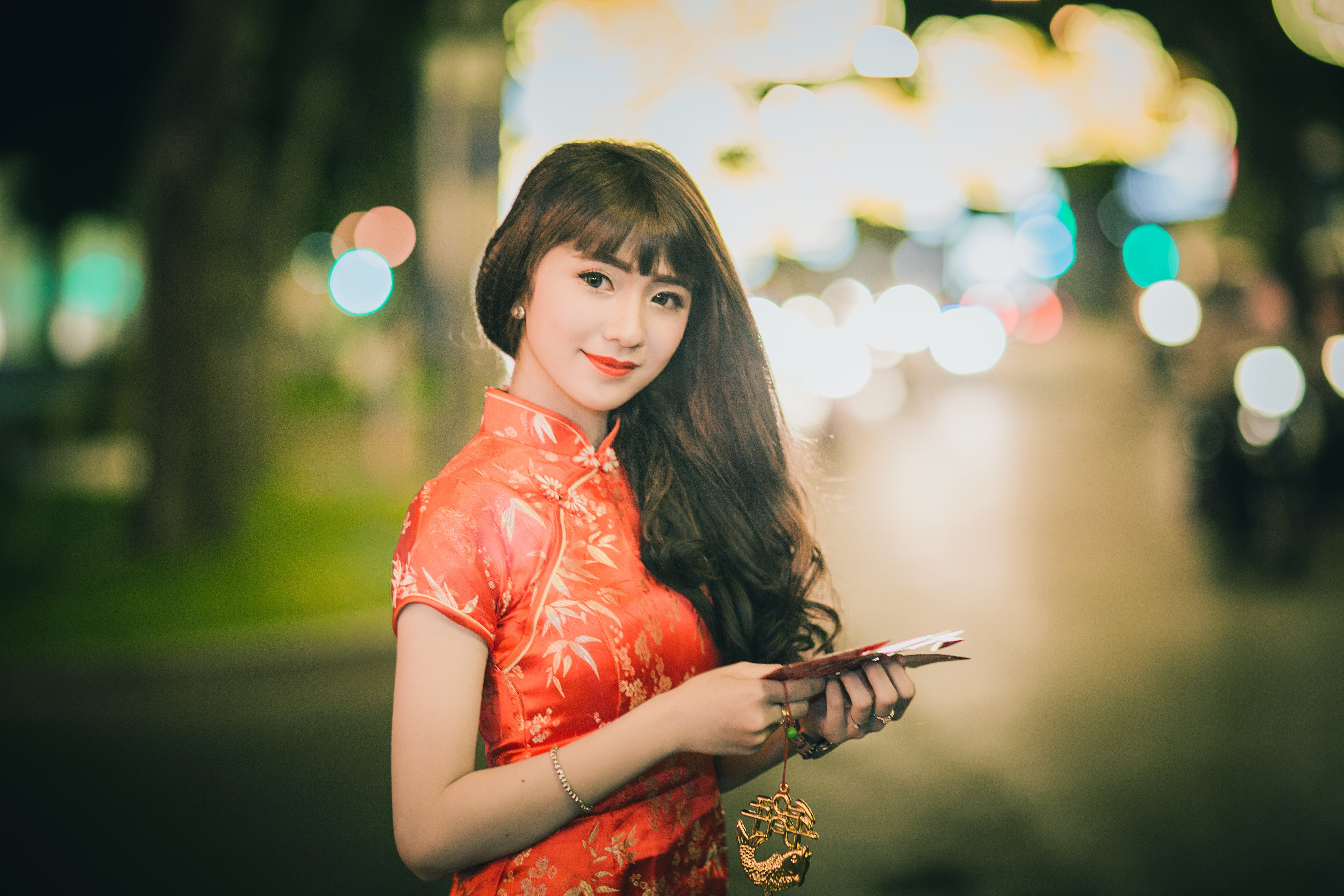 Woman Wearing Red and Brown Chinese Dress