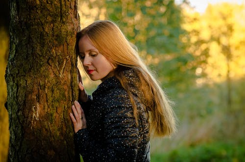 Woman Leaning on the Tree