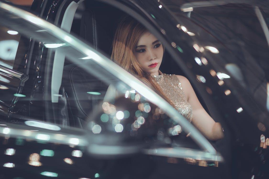 Woman Sitting Inside Black Vehicle