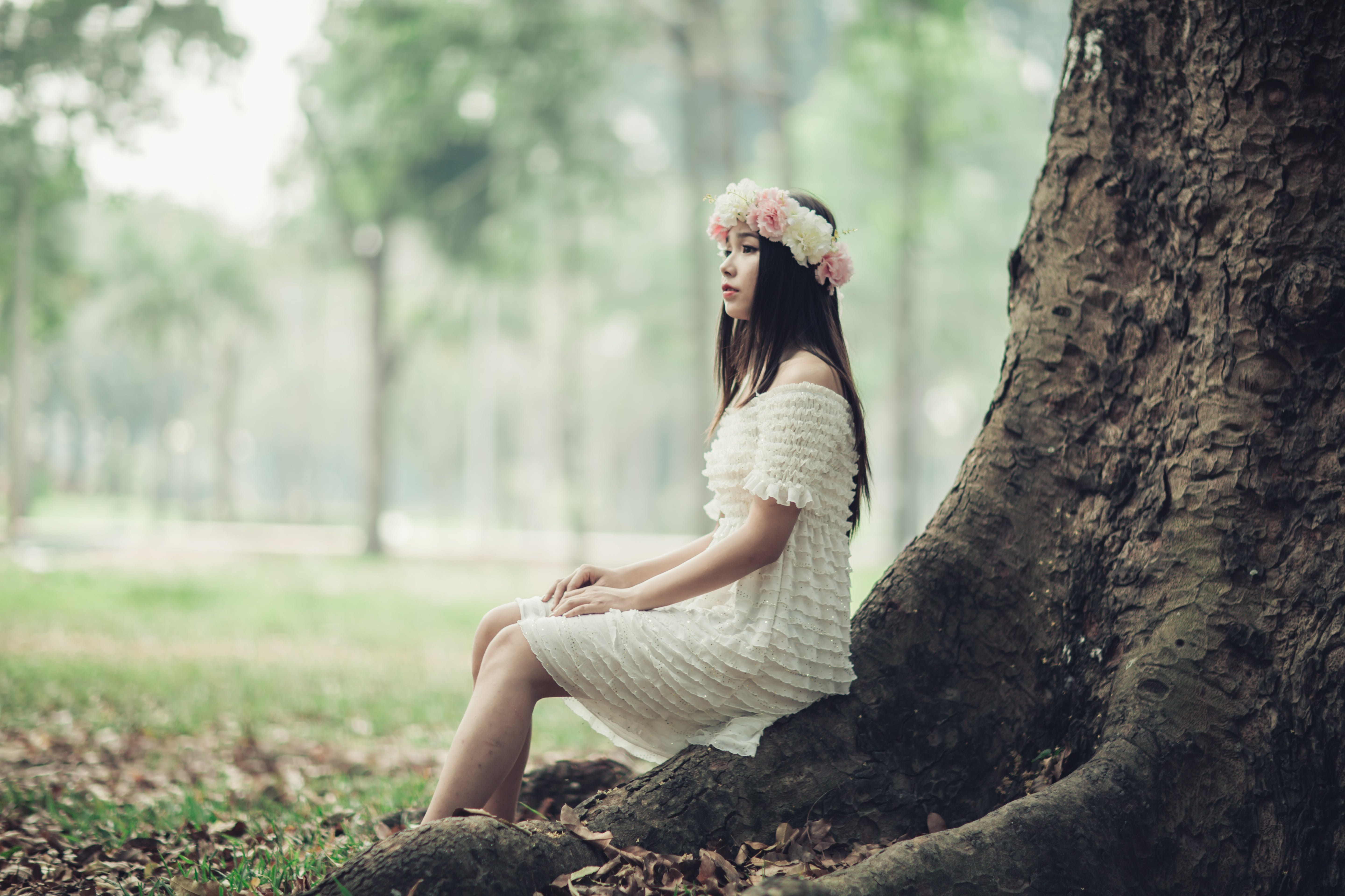 Woman Sitting on Tree Root