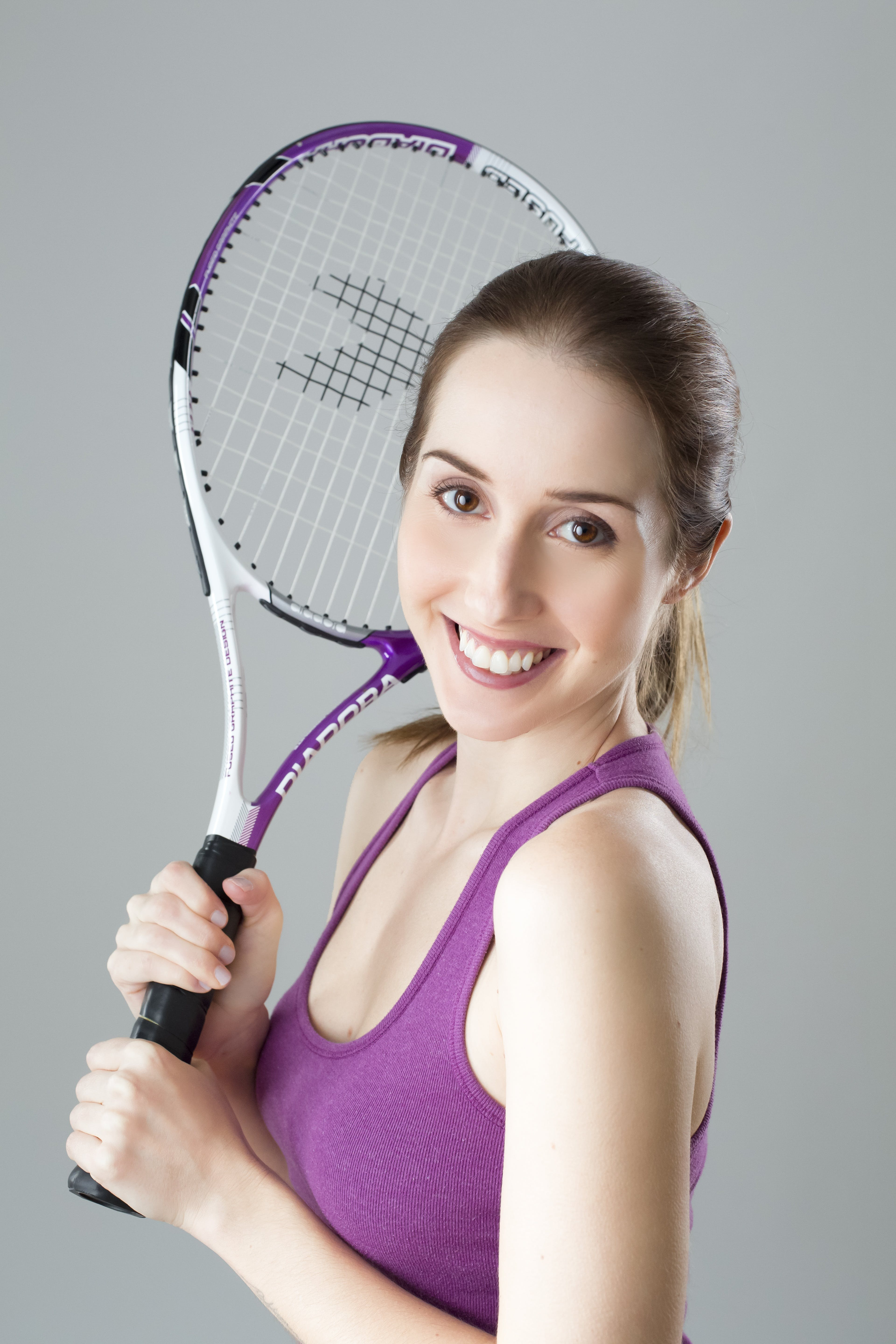 Woman Holding Purple Tennis Racket