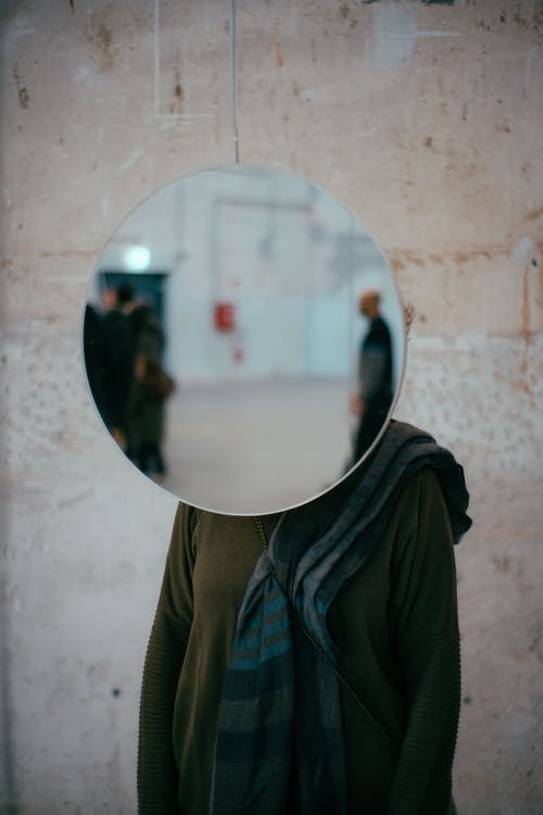 Mirror Covering Person Face
