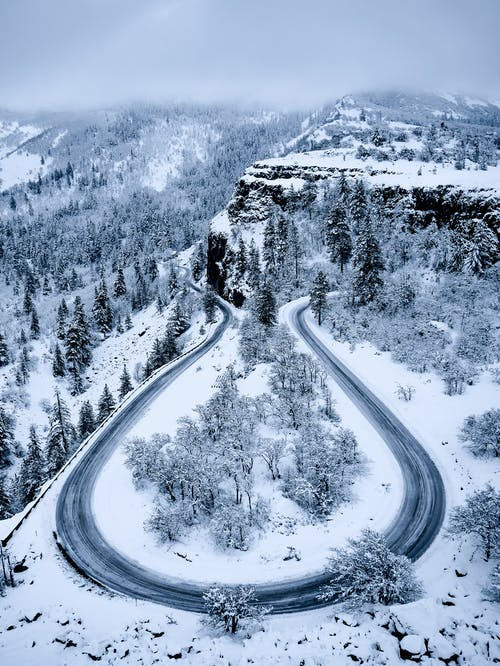 Bird's Eye View of Curved Road during Winter