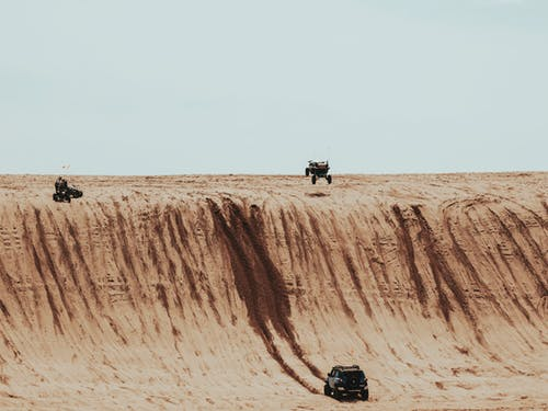 Black and Gray Four Wheel Drive on Desert