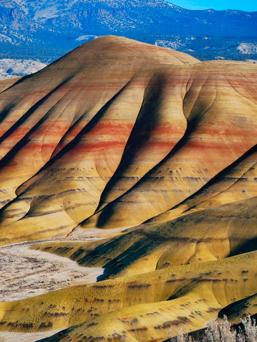 Picturesque view on Painted Hills located in United States and composed of many different colored geological layers