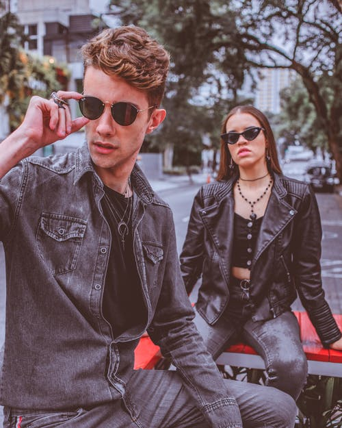 Man and Woman Wearing Jackets and Sunglasses