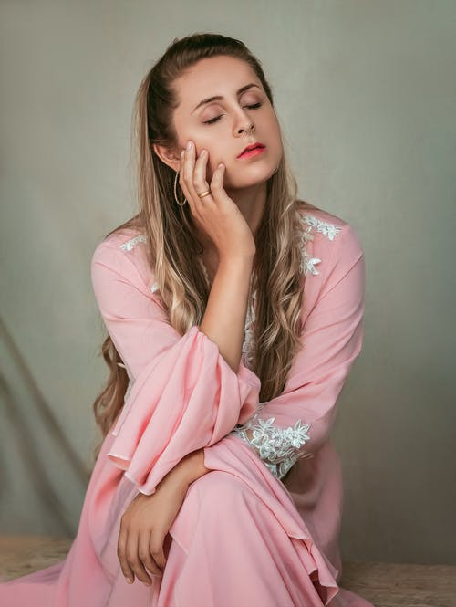 woman in a pink outfit