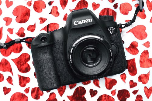 Black Canon Eos 6d Camera on Red and White Surface